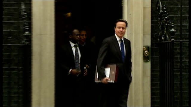 clegg proposes security bond for new immigrants downing street prime minister david cameron mp from number 10 and to car - david bond stock videos & royalty-free footage