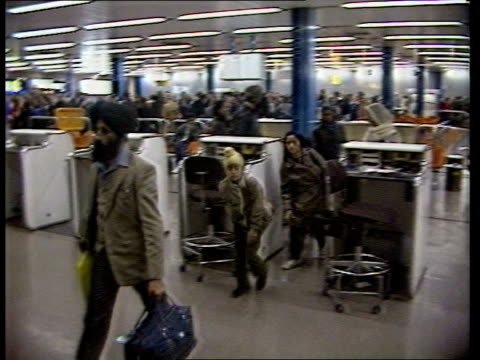immigration control procedures biased says report itn london lap asian family towards through passport control - emigration and immigration stock videos & royalty-free footage