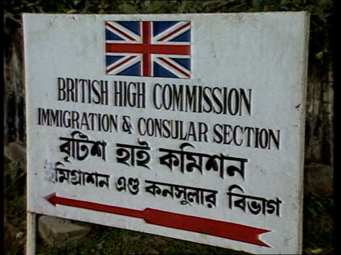Immigration control procedures biased says report ITN Syinet Woman holding child PULL OUT to group of Indians standing outside British High...