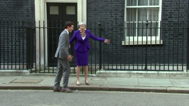 Corbyn and May clash over Windrush generation ENGLAND London Downing Street EXT Theresa May MP greeting Justin Trudeau and posing for photocall on...