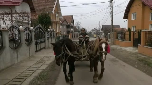 'destination britain' romanian communities transformed by money earned in uk romania transylvania ratsca shot through car window as along past large... - transylvania stock videos & royalty-free footage