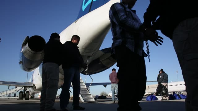 Immigration detainees being searched and loaded onto a deportation flight Immigration detainees being searched and loaded on February 28 2013 in Mesa...