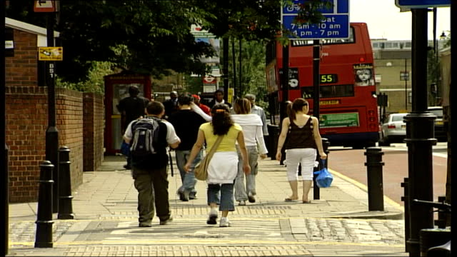 fears over eu expansion; general view of pedestrians down steps of train station entrance hackney: back view of man looking at jobs notice board... - vox populi stock videos & royalty-free footage