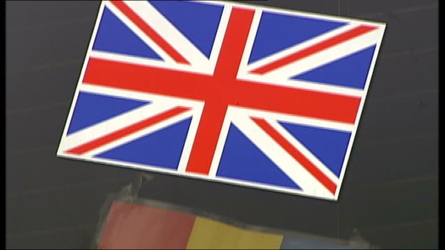 immigration from romania and bulgaria on the rise; konstantin dimitrov interview sot ext close up shot union jack and romania flags in window... - gloria de piero stock videos & royalty-free footage