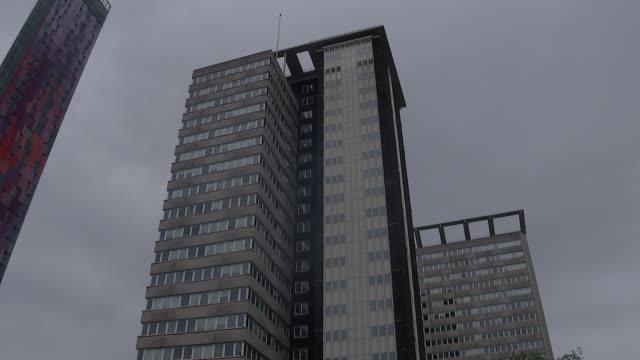 lunar house general views; england: london: croydon: lunar house: ext gvs lunar house / reflection in puddle / entrance / windows / 'home office - uk... - ロンドン クロイドン点の映像素材/bロール