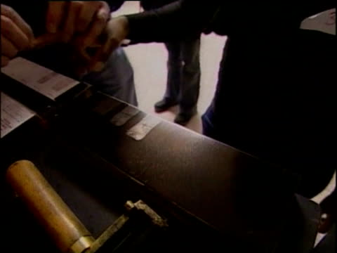 immigration officer takes fingerprints from suspected illegal worker shropshire; 30 jun 05 - undocumented immigrant stock videos & royalty-free footage
