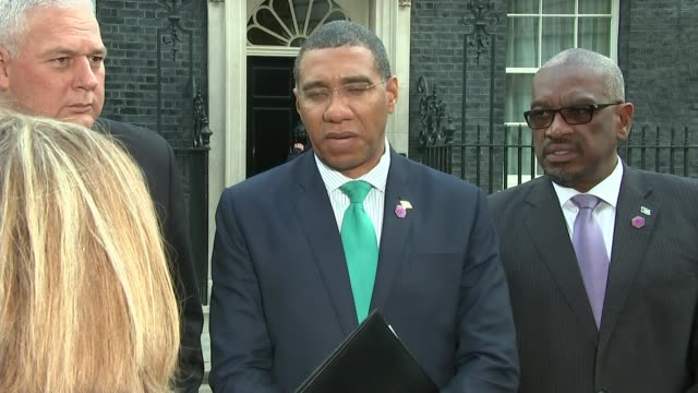 theresa may apologises to 'windrush' generation threatened with deportation downing street ext andrew holness exiting number 10 along with other... - downing street stock videos and b-roll footage