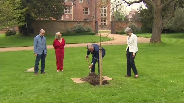 Windrush scandal Calls for Windrush generation to receive damages Buckinghamshire Chequers EXT Malcolm Turnbull planting tree with Theresa May MP May...