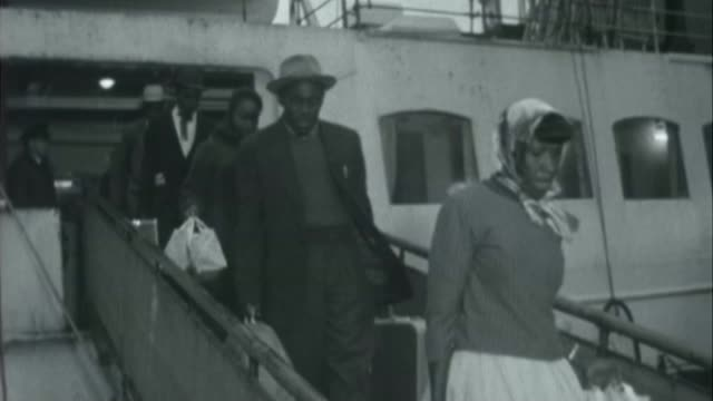 windrush scandal calls for windrush generation to receive damages x10026503 / france calais ship at harbour b/w various of west indian migrants... - hmt empire windrush stock videos & royalty-free footage