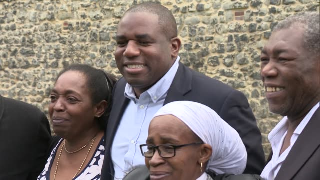 windrush scandal: david lammy photo call; england: london: westminster: ext various of david lammy mp posing with members of the windrush generation... - photo call stock videos & royalty-free footage
