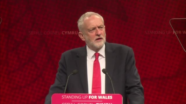 Windrush scandal Jeremy Corbyn brands Theresa May personally responsible WALES Conwy Llandudno INT Jeremy Corbyn MP along stage / speech SOT This...
