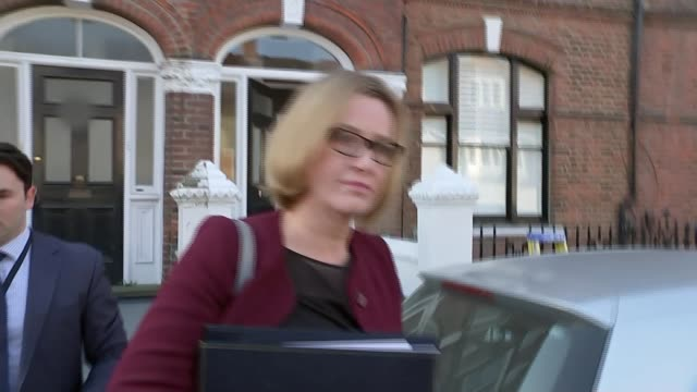 Windrush scandal Theresa May pledges 'appropriate' compensation ENGLAND London EXT Amber Rudd MP along from house to car as ignoring questions