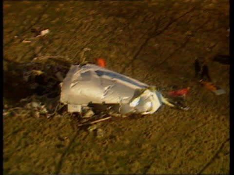 imminent suspects handover lib scotland lockerbie ext air view wreckage of nose cone of pan am plane on hillside as investigators along to it - lockerbie stock videos & royalty-free footage