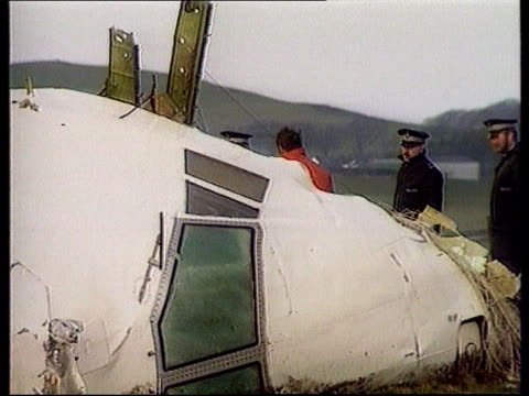 imminent suspects handover lib scotland lockerbie ext wreckage of nose cone of pan am plane on hillside as investigators along to it air view nose... - lockerbie stock videos & royalty-free footage