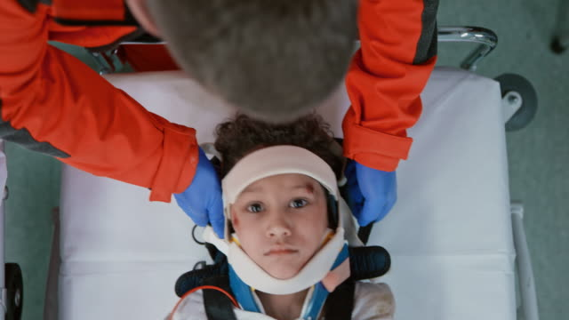 stockvideo's en b-roll-footage met immobilized child transferred to a stretcher by the paramedics - ongelukken en rampen