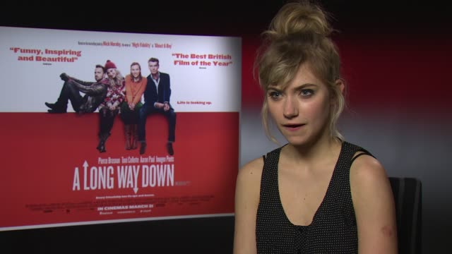 imogen poots on the cast and working with former james bond pierce brosnan at 'a long way down' interview at on february 14, 2014 in london, united... - キャラクター ジェームズ・ボンド点の映像素材/bロール