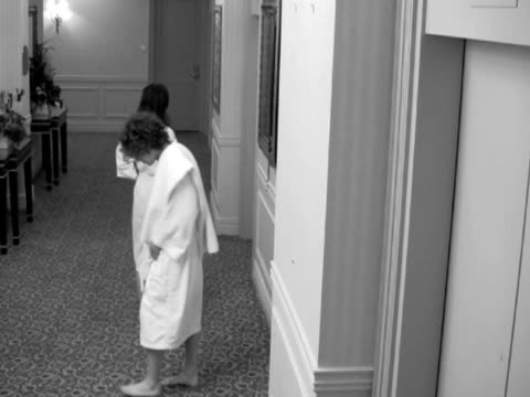 impatient couple waiting for hotel elevator - bathrobe stock videos & royalty-free footage