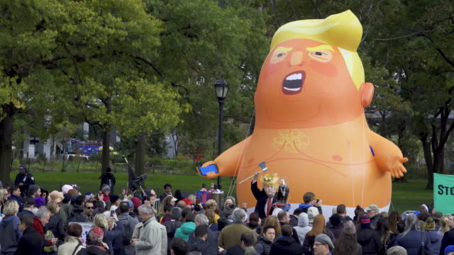 impeachment parade'- anti president donald trump demonstrators rallied at battery park in downtown manhattan and marched to the trump building at 40... - inflatable stock videos & royalty-free footage