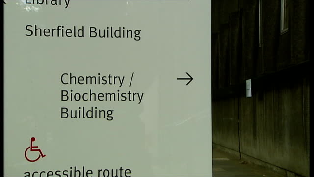 university building sign to biochemistry building students sitting on steps professor steven matthews interview sot - biochemistry stock videos & royalty-free footage