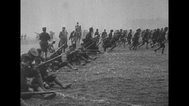vs imperial japanese army and national revolutionary army battle in manchuria / medics run with stretcher / flag of manchukuo flutters in breeze /... - mandschurei stock-videos und b-roll-filmmaterial