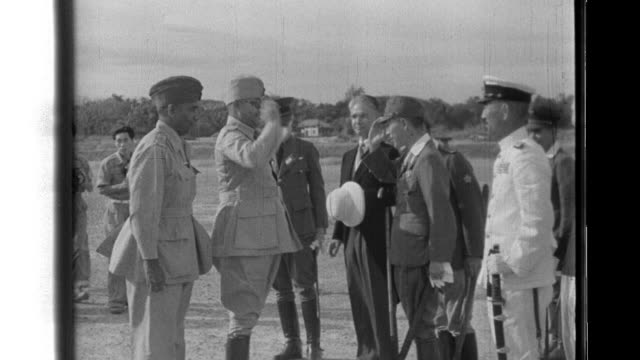 stockvideo's en b-roll-footage met imperial japanese army and navy officers greet indian independence leader subhas chandra bose at the rangoon airport where he is given wreathes... - officier militaire rang