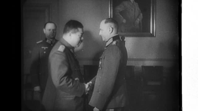 imperial japanese army lieutenant general tomoyuki yamashita presents german field marshal walther von brauchitsch with a japanese sword during world... - field marshal stock videos and b-roll footage