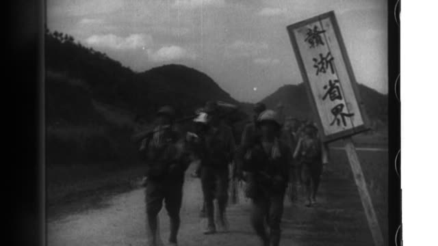 Imperial Japanese Army soldiers advance into Jiangxi Province where the 13th Army troops engage the enemy and use machine guns and artillery...