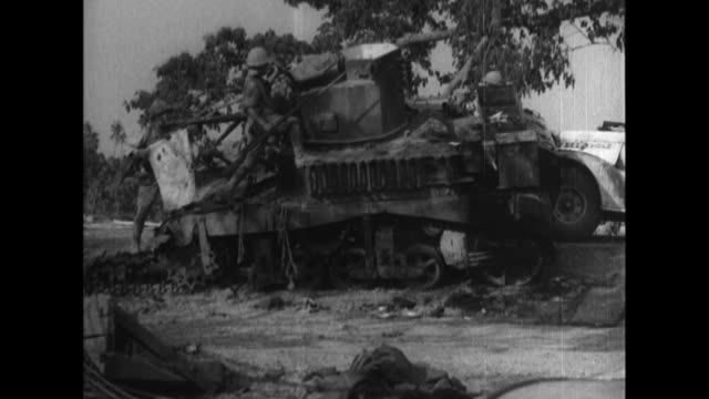 vídeos y material grabado en eventos de stock de imperial japanese army soldiers inspect destroyed enemy vehicles, then build and repair bridges, guard railway lines, and advance by foot and vehicle... - infantería