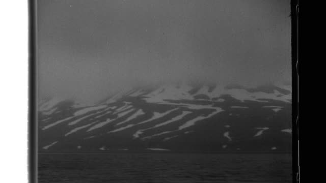imperial japanese army soldiers of the north sea expeditionary army use ladders to scale cliffs, snow shoes to travel, and often slip as they battle... - japan flag stock videos & royalty-free footage