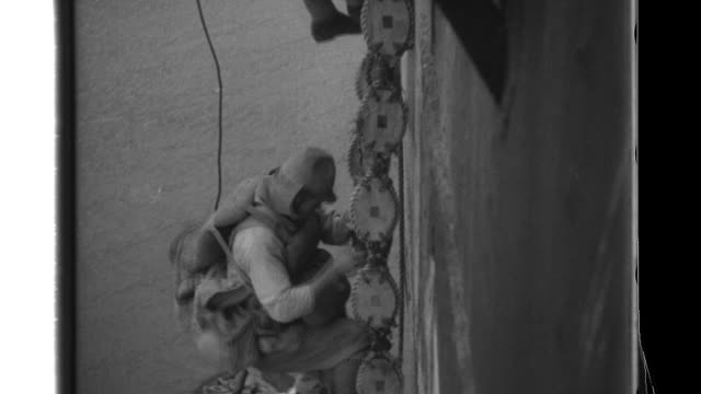 Imperial Japanese Army soldiers use Jacobs ladder to disembark from a transport ship then proceed ashore and battle inland where they are welcomed by...