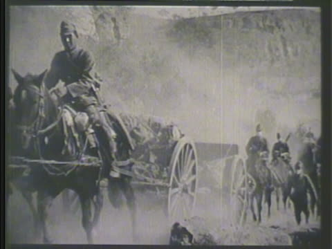 stockvideo's en b-roll-footage met imperial japanese army troops on horseback moving along yangtze river pulling carts w/ supplies bags vs soldiers traversing river waters across... - recreatief paardrijden