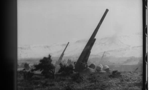 imperial japanese army troops practice infantry artillery and anti tank warfare tactics and then ski as they engage in cold weather maneuvers in the... - artiglieria video stock e b–roll