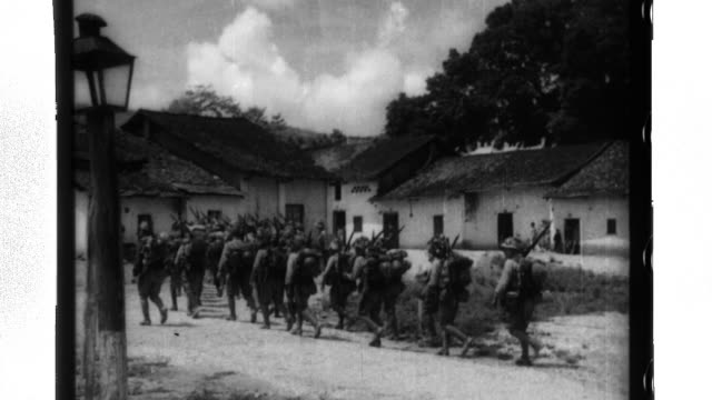 imperial japanese forces of the 5th division under nakamura enter and occupy french indochina then march in review at lang son - indocina video stock e b–roll