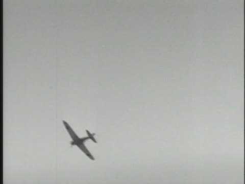 """Imperial Japanese Navy Air Service Mitsubishi A6M Zerosen """"Zero"""" """"Zeke"""" fighter aircraft flying through sky flying over clouds second..."""