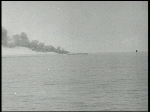 stockvideo's en b-roll-footage met imperial japanese navy battleships firing antiaircraft artillery cannons vs smoking rising in distance vs japanese carriers damaged sailors on... - 1942