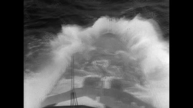 imperial japanese navy crews battle the elements as ice forms on the exposed surfaces of their warships when they sail through storms in the north... - north pacific stock videos & royalty-free footage