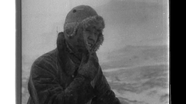 imperial japanese occupation forces brave the elements as they brave a blizzard messmen cook outdoors and the naval garrison sings in the snow - japanese military stock videos & royalty-free footage