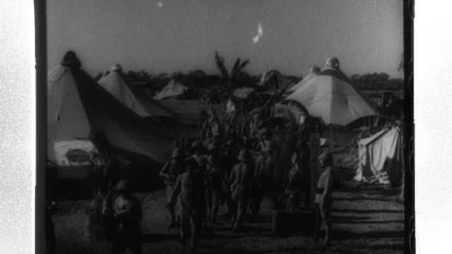 imperial japanese service members stationed in french indochina celebrate new year as they place gate pines in front of their tents and decorate... - shimenawa stock videos & royalty-free footage