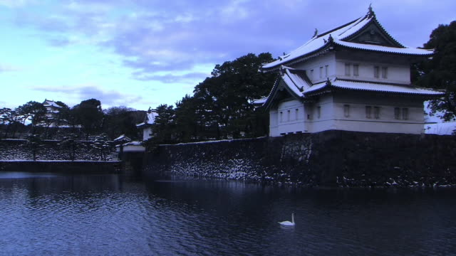 imperial palace and moat covered with thin layer of snow, tokyo - kanto region stock videos & royalty-free footage