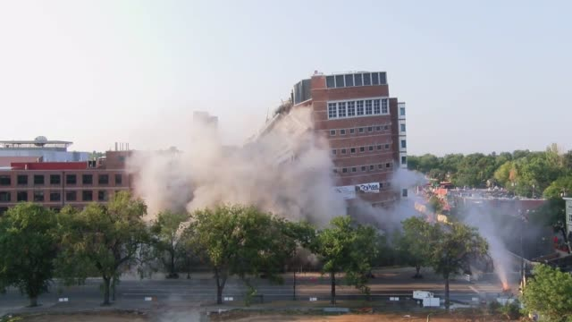 implosion of the former university of colorado health sciences center biomedical resarch building at e ninth ave and colorado blvd went off without a... - imploding stock videos and b-roll footage