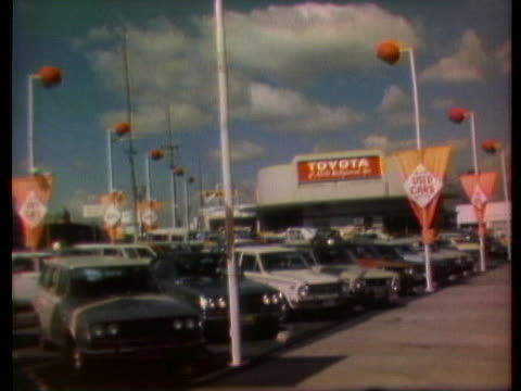 imported cars stand on a los angeles dock and in car dealers' lots. - car showroom stock videos & royalty-free footage