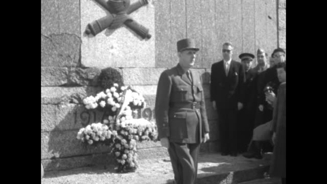 imposing gen. charles de gaulle walks past several french tricolor flags and lays cross of lorraine wreath at memorial dedicated to wwi mechanized... - wwi tank stock videos & royalty-free footage
