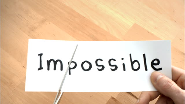 impossible to possible by scissors - conquering adversity stock videos & royalty-free footage