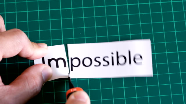 impossible to possible concept by cutter knife. - plain stock videos & royalty-free footage