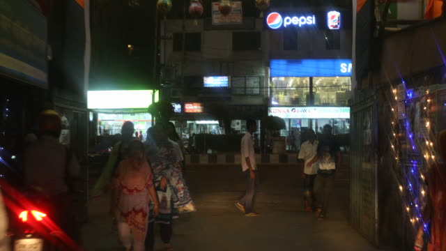impressions of road traffic at night in dhaka many people in their cars can be seen on the street the roadsides are illuminated because of durga puja - bangladeshi culture stock videos & royalty-free footage
