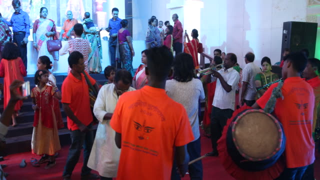 stockvideo's en b-roll-footage met impressions of the durgapuja festival in farmgate in dhaka in bangladesh, musicians are playing. durgapuja is the largest hindu festival of... - number 9