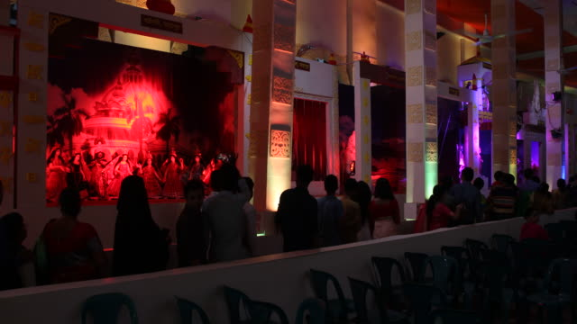 impressions of the durgapuja festival in farmgate in dhaka in bangladesh visitors are joining the festival durgapuja is the largest hindu festival of... - bangladeshi culture stock videos & royalty-free footage