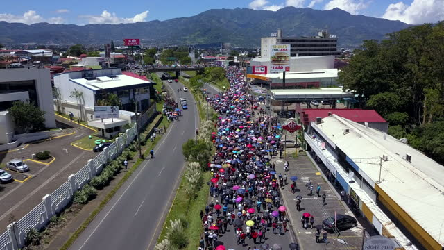 impressive aerial view of a manifestation march in costa rica. a stricklands against government pac - international politics stock videos & royalty-free footage