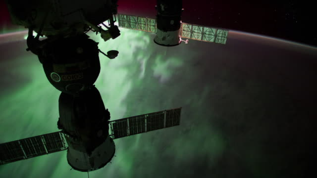 impressive and stunning view of the blue planet at night. aurora borealis slowly showing underneath the iss. the soyuz brand can be seen in the... - aurora australis stock videos & royalty-free footage