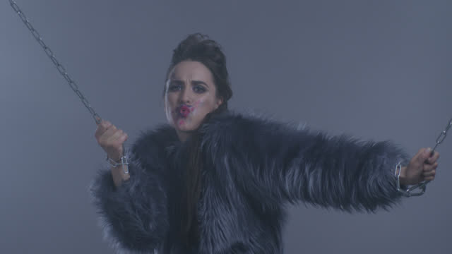 imprisoned with chains brunette high fashion model in fur. fashion video. - chain stock videos and b-roll footage